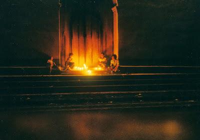 Children with candles on church steps for All Saints Day or Dia de los Santos in Sociedad, El Salvador