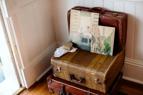 Photo boards on top of old suitcases