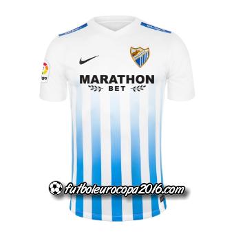 45ec968a46599 El camiseta malaga tercera 2016-2017 introduce un uniforme a rayas con  clase busca el club en azul marino oscuro y azul claro