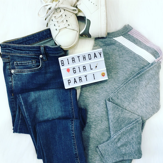 Flatlay grey jumper and jeans