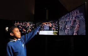 Child using one of the conductor pods, Universe of Sound, Philharmonia Orchestra, Science Museum