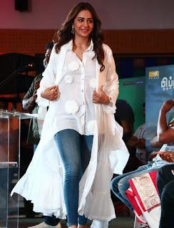 Rakul Preet HD Pics in White Dress And Blue Jeans