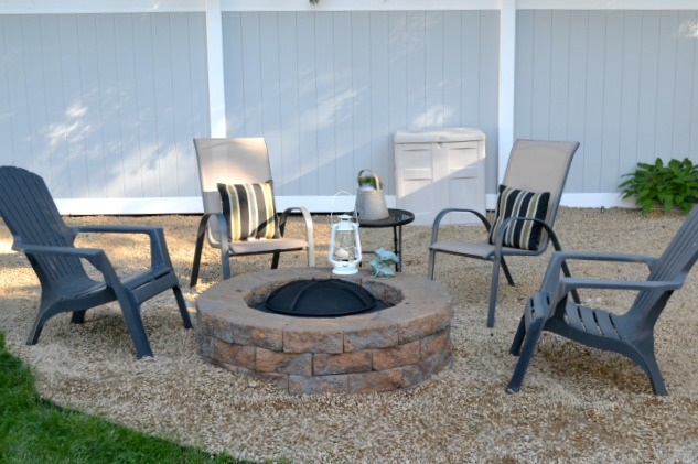 Fire pit with chairs around in pea gravel