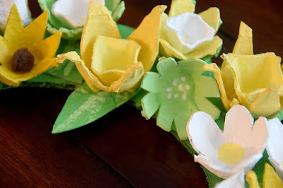 close up of yellow and white flowers made with egg cartons