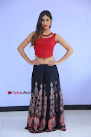 Telugu Actress Nishi Ganda Stills in Red Blouse and Black Skirt at Tik Tak Telugu Movie Audio Launch .COM 0005.JPG