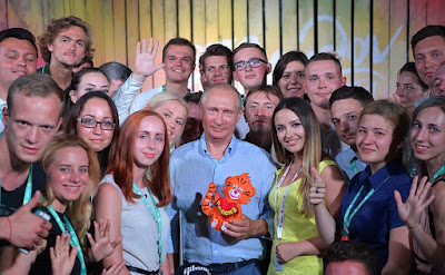 Vladimir Putin with children at Tavrida National Youth Educational Forum.
