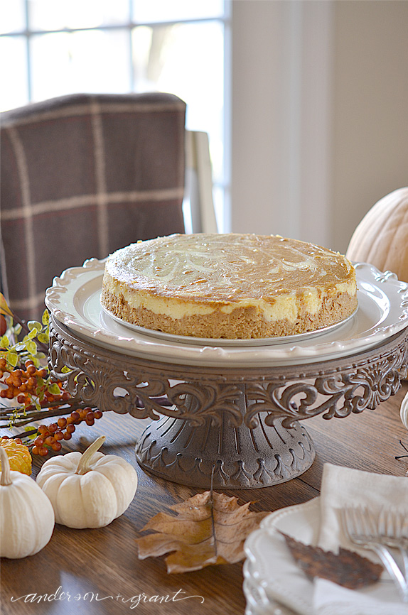 Pumpkin cheesecake sitting on cake stand