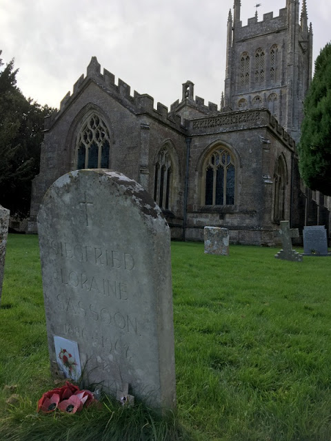 gravestone with old church behind