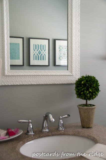 White Vintage Mirror, DIY Artwork, Boxwood Topiary in the Bathroom. Postcards from the Ridge.