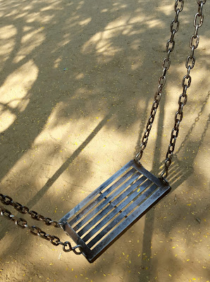 A Minimalist Photo of a metal swing shot by Samsung Galaxy S6 Smart Phone
