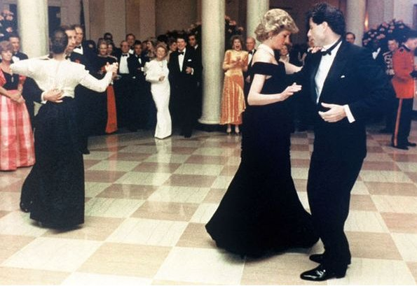 Princess Diana dances with John Travolta, Nancy Davis Reagan, Ronald Reagan. Princess Diana visit Italy  wore Emanuel blue tartan suit. blue velvet Victor Edelstein evening gown at Whitehouse
