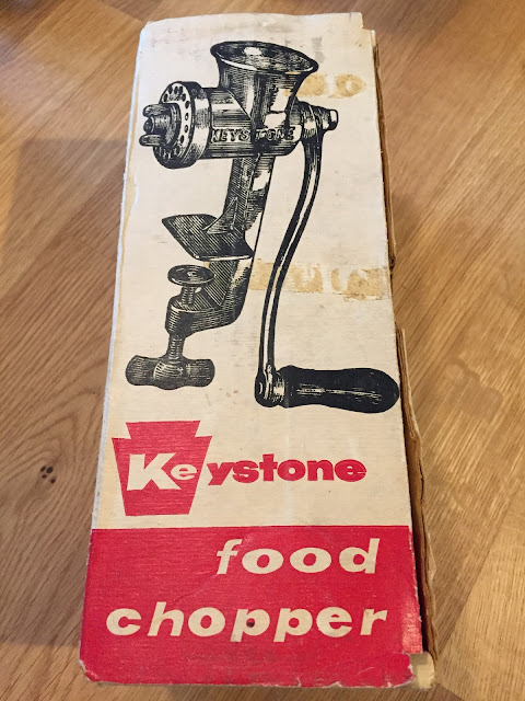 Old-fashioned meat grinder in box