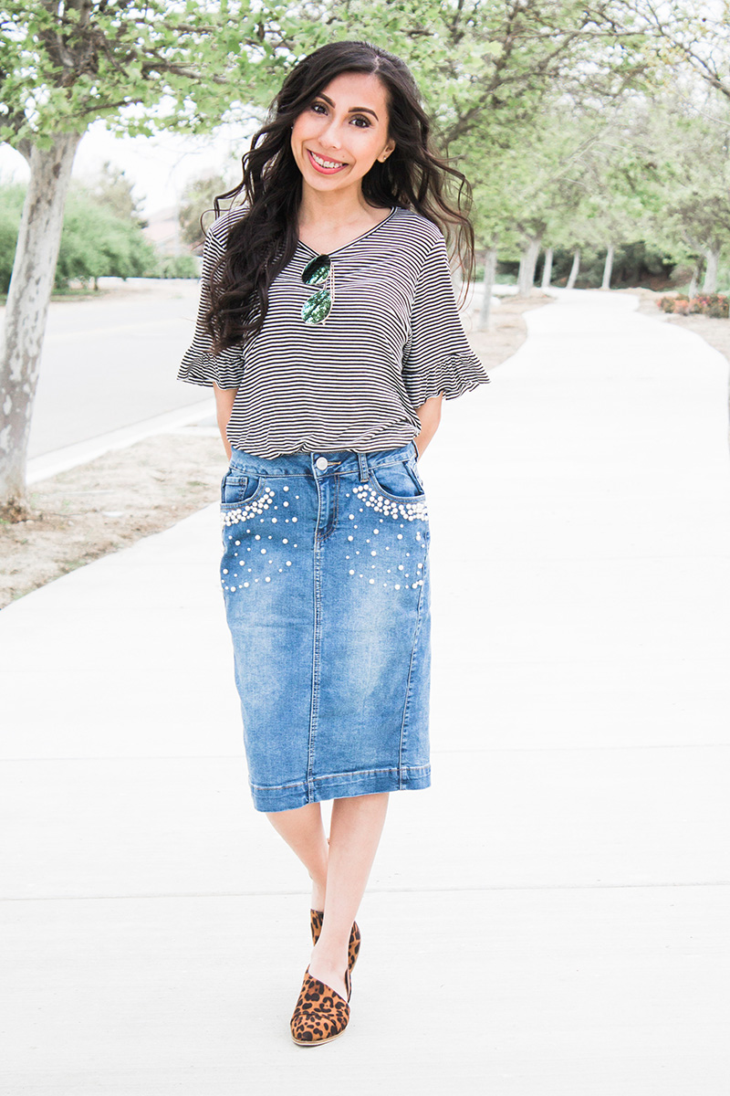 pearl denim skirt with striped top and leopard cut out booties