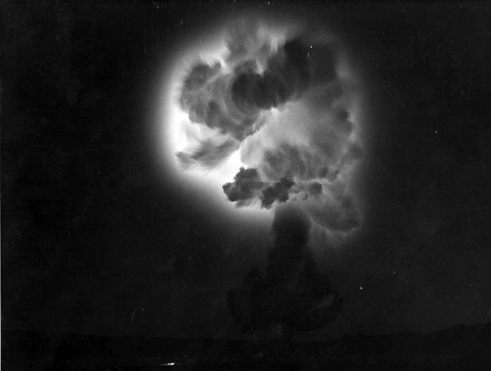 Ionization glow surrounds the cooling fireball of the Diablo shot, fired in Yucca Flat at 4:30 a.m. on Monday, July 15, 1957.