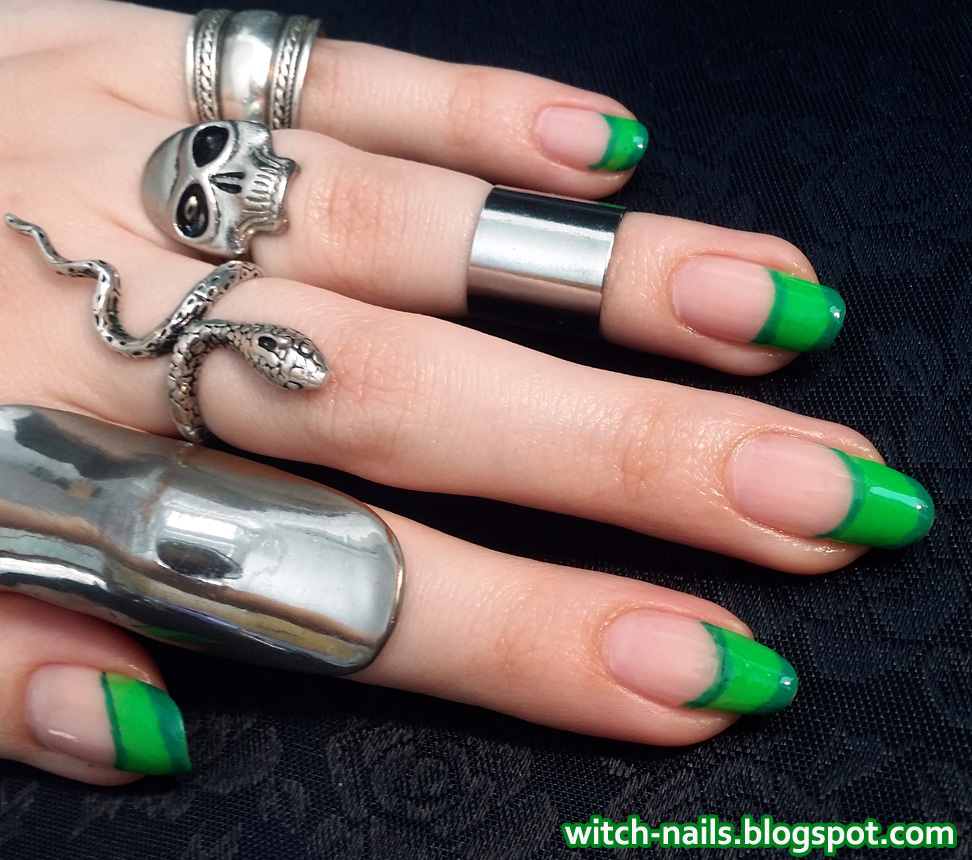 neon poison green nails with skull and snake rings