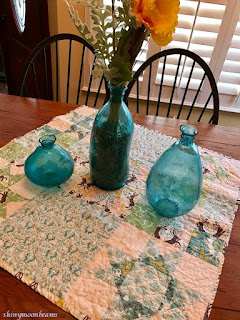 easter table with blue vases