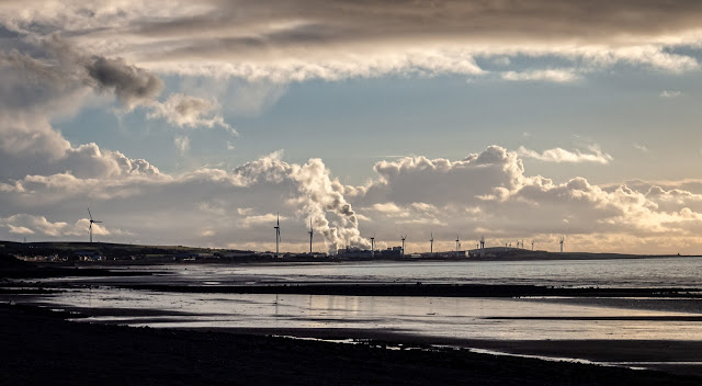 Photo of Maryport shore looking towards Iggesund paperboard mill at Workington
