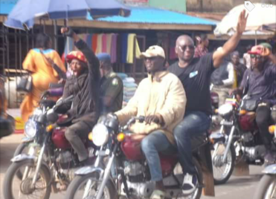 Photos: Fayose hops on a motorcycle for a ride to the state Govt house