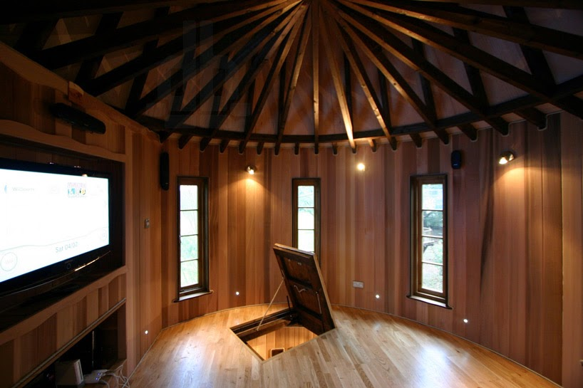 4. Whoa! There's even a secret room! - This Family Lives In A Tree House That Looks Like A Castle. Think That's Cool? Wait Until You See The Inside.