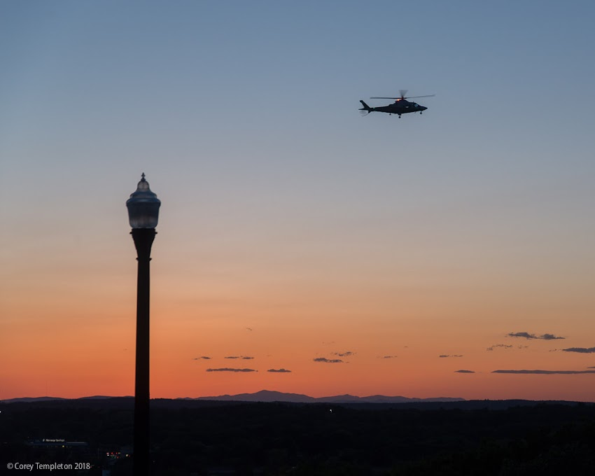 Portland, Maine USA June 2018 photo by Corey Templeton. A LifeFlight of Maine helicopter passes over the Western Promenade, on the approach to Maine Medical Center.