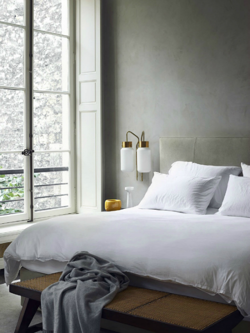 Bedroom with grey walls and lamps in brass