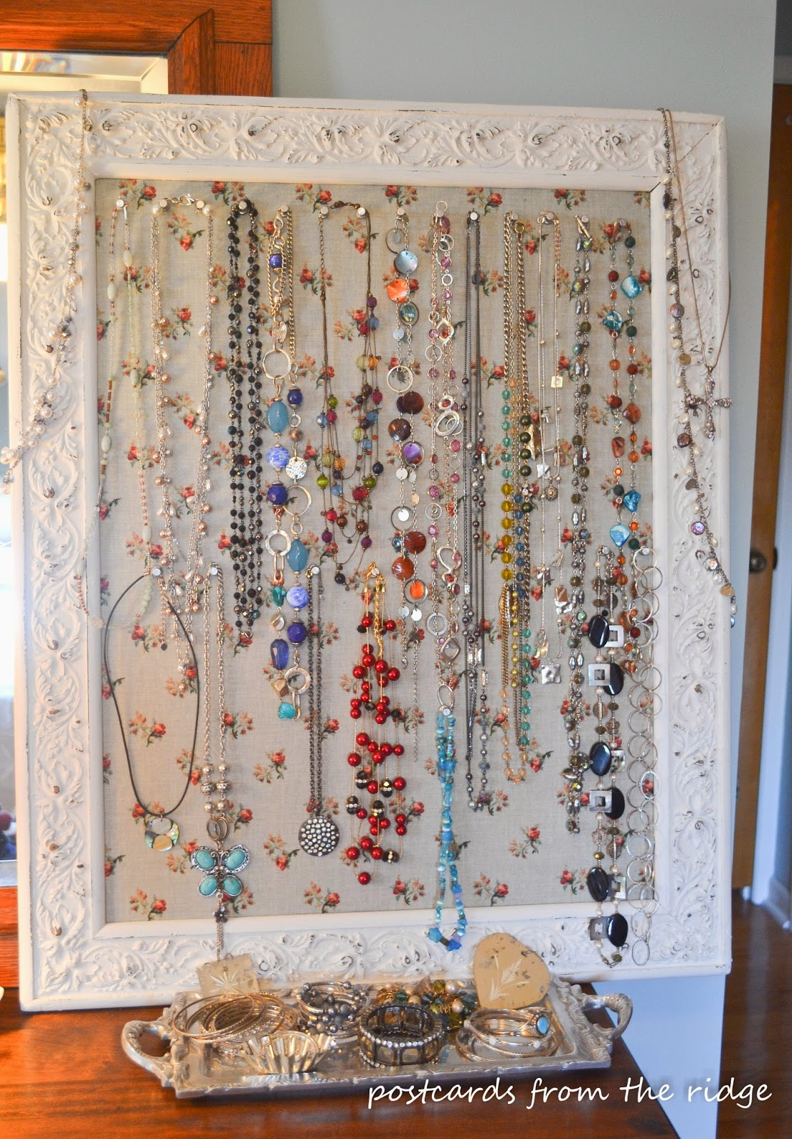 An old beat up frame turned into a jewelry board, plus other great ideas for jewelry organization.