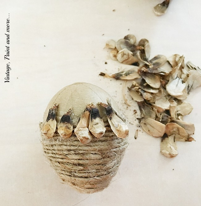 Vintage, Paint and more... gluing the seeds of the pine cone on the twine wrapped egg to make the acorn cap