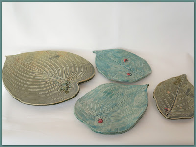 Beautiful leaf ceramic plates with frogs, snakes, and ladybugs, pottery by Lily L.