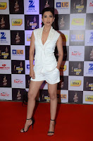 Actress Gauhar Khan  Pictures in White Shorts at Mirchi Music Awards 2016  0003.jpg