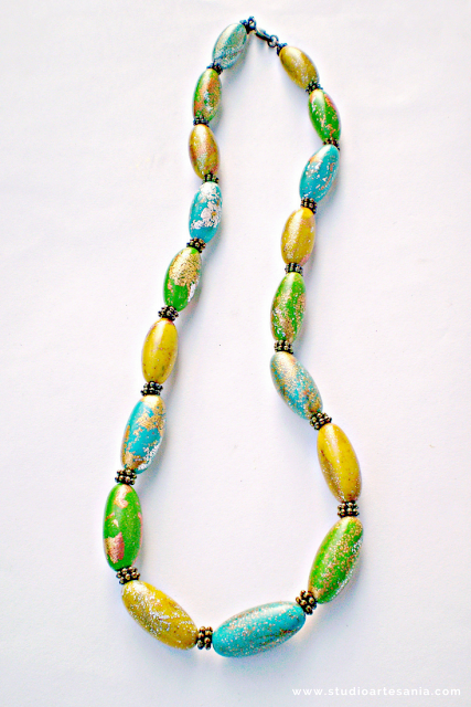 DIY Cheerful polymer clay necklace: In this tutorial, you will learn how to mix your own colors of polymer clay, make crackled beads and connect them in the fancy necklace.