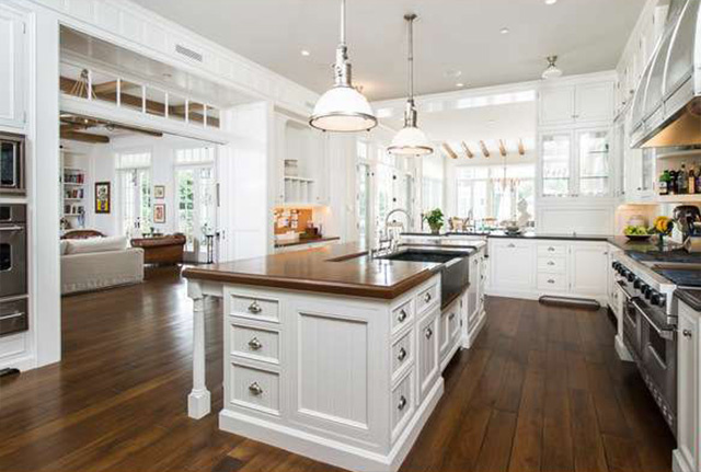 Traditional white kitchen in Cliffwood traditional mansion home designed by Steve Giannetti in Brentwood Park