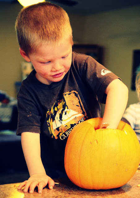 Image of My Son Carving a Pumpkin