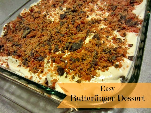 The original Butterfinger Dessert by Renee's Kitchen Adventures in a clear glass baking pan