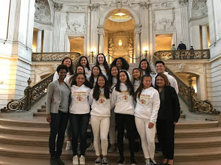 The Lincoln High varsity girls' volleyball team poses for a photo in the City Hall rotunda.