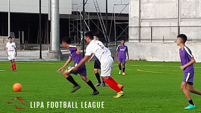 Action in the Lipa Football League.