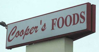 Cooper's Foods sign with handwriting script Cooper and straight apostrophe