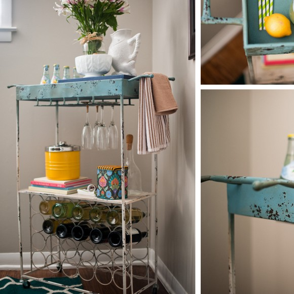 Cute decorative towels and fresh flowers make this bar cart stylish.