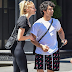 Joe Jonas and fiancée Sophie Turner wearing matching purses while walking in New York.