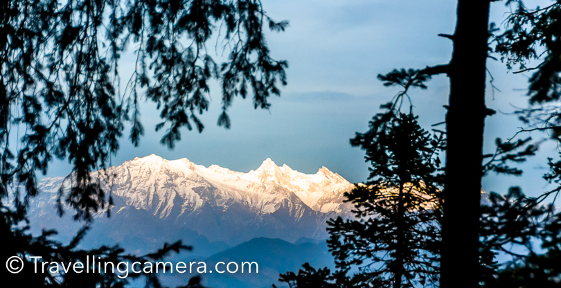Now that lot of travellers are moving away from typical tourist destinations, people are choosing places like Narkanda and the popularity of such places is increasing fast. Narkanda is located on NH-22 which connects Shimla with Kinnaur and surrounded by snow covered peaks. Beautiful landscapes with snow covered peaks, blue sky and high deodars make this place very special. Narkanda is not only a small town in Himachal, but it's a region which has lot to offer for explorers/travellers.How to reach Narkanda - Narkanda town is 60 kilometers from Shimla and very well accessible through local buses. The road from Shimla to Narkanda is superb except a stretch near Shimla/Sanjauli towns. It takes approximately 1.5 hours from Shimla to Narkanda. If you are driving in your own vehicle, it's recommended to stop at Shilaroo Hockey stadium Dhomri  is closest camping place to Narkanda. It's at a walking distance from the town. First photograph of this Photo Journey is clicked at Dhomri. This was clicked few years back during MTB Himalaya rally . And this is the place where skiing trainings and competitions happen in winters.If we look at Narkanda Pictures on internet, you wold find lot of hikes around Narkanda and Hatu peak  is one of the most popular place amongst hikers, Trekkers, bikers  and adventure lovers. Check out the link above to know about this place. This place is also surrounded by beautiful forests. This place is also quite interesting for camping. Hatu peak is probably the highest peak in this region and it's must to experience the wind on the top.Most of the Narkanda Hotels have great view of snow covered peaks. I have stayed in HPPWD guest house and HPTDC hotel in Narkanda. Both of these properties are very well located around the town.Narkanda tourism is picking up and it's quite encouraging. Most of folks who plan shimla kinnaur trip should definitely consider taking a break around this region of Shimla. As you move further from Narkanda, the landscapes become more beautiful. Road passes through deodar forests and suddenly you come across great views of snow covered peaks Another interesting place around Narkanda is Tani Jubber lake which is close to Kotgarh. It's a beautiful lake surrounded by deodar forest. I was also fortunate to camp at Tani jubber as well. Once, we had installed our tents in playground of government school which is near to Tani Jubber lake. And one night was spent in an apple orchard. If you keep walking on the road adjoining lake, you would find lot of apples. July/August is best time to see red apples on these trees.Kotgarh shimla region is popular for it's export quality apples and cherries. As you enter Kotgarh region, you see apple orchards all around. Apart from apple, you can find cherries, kiwi, apricot, peach, wallnut, almond trees as well. There are some nice home stays in Kotgarh region. I have never stayed in homestays of Kotgarh, but that's in my list. And I want to visit this region again in July time, which is harvest season for villagers.If you keep driving towards Kinnaur, you hit the place where Satluj will start following you.I am sure that Narkanda has lot more than what I have shared in this post. If you are keen in knowing more, click on links embedded in this post which talk about specific destinations around Narkanda and what makes them so special. Camping is definitely something that should be planned in this part of Himachal Pradesh. Hope to share more camping photographs soon.