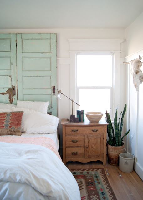 Farmhouse Master Bedroom Reveal - Benjamin Moore Simply White, farmhouse trim , board and batten, cow skull, snake plant