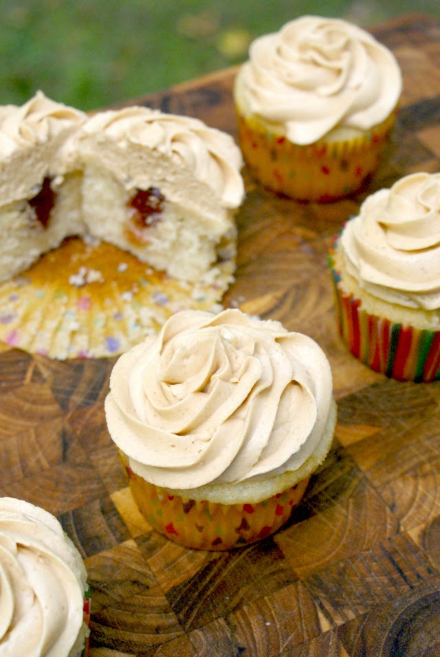 Peanut Butter and Jelly Cupcakes are moist yellow cupcakes with creamy peanut butter buttercream frosting and a sweet jelly center.