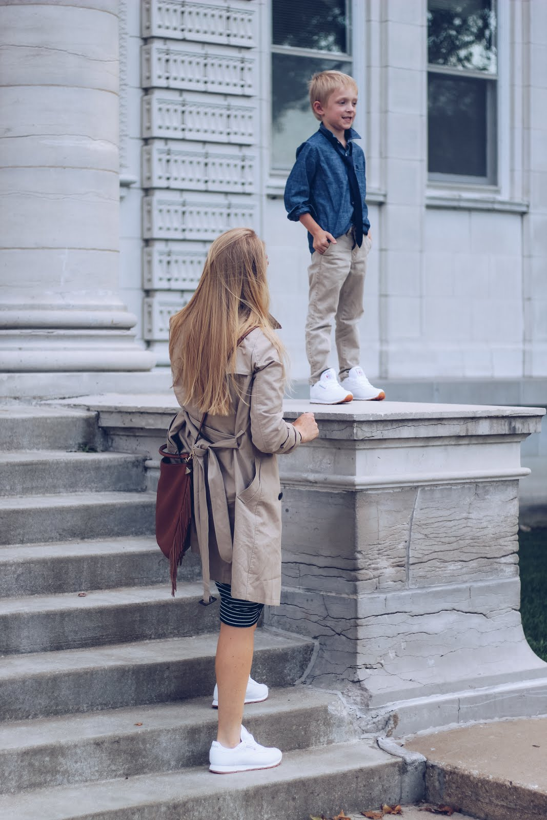 white reebok classics. mom outfit. mother son outfits. fall outfit with tennis shoes. trench coat outfit.