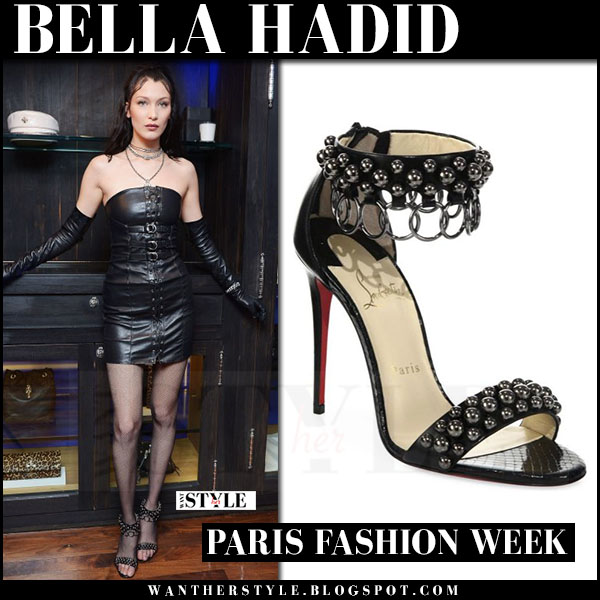 Bella Hadid in black leather mini dress chrome hearts and black ankle strap sandals christian louboutin gypsandal what she wore paris fashion week