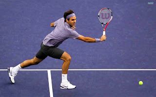 Tennis ace Roger Federer vows to win more trophies