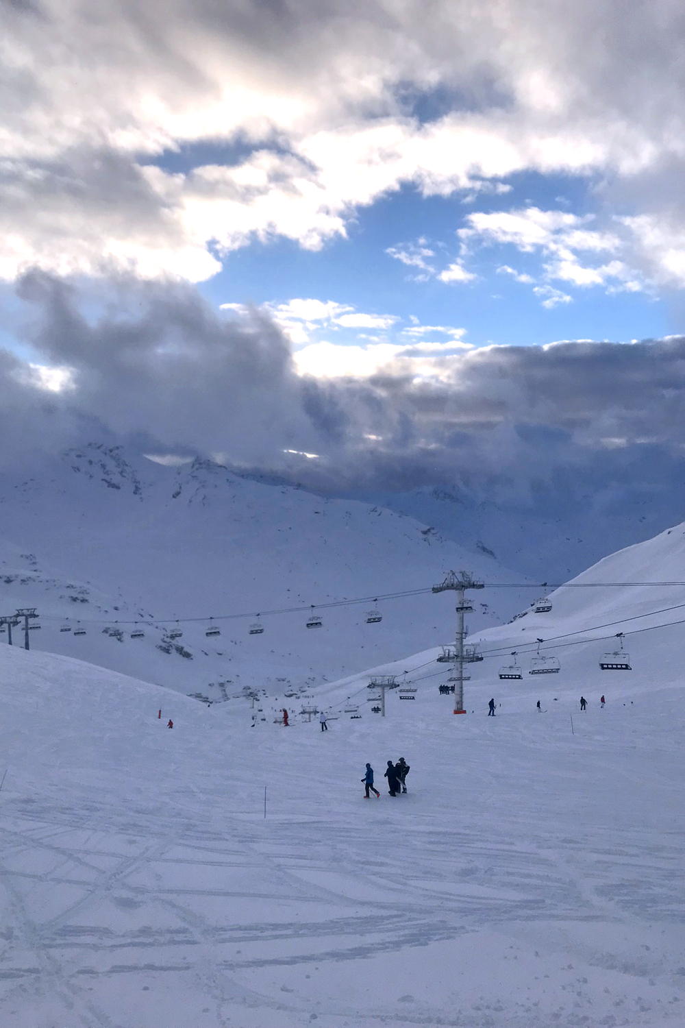 Cloudy blue skies in Val Thorens, France - travel & lifestyle blog
