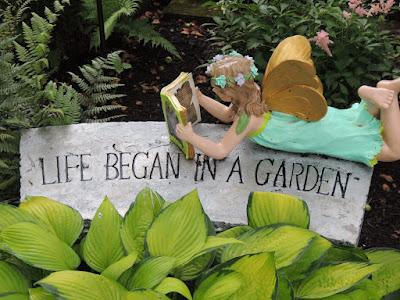 A garden, a book, and a bench- nice combo.