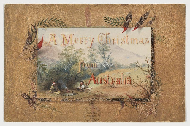 """Christmas Card design depicting two men, a bushman and policeman, sitting at a camp fire and a dog with the words """"Merry Christmas from Australia""""."""