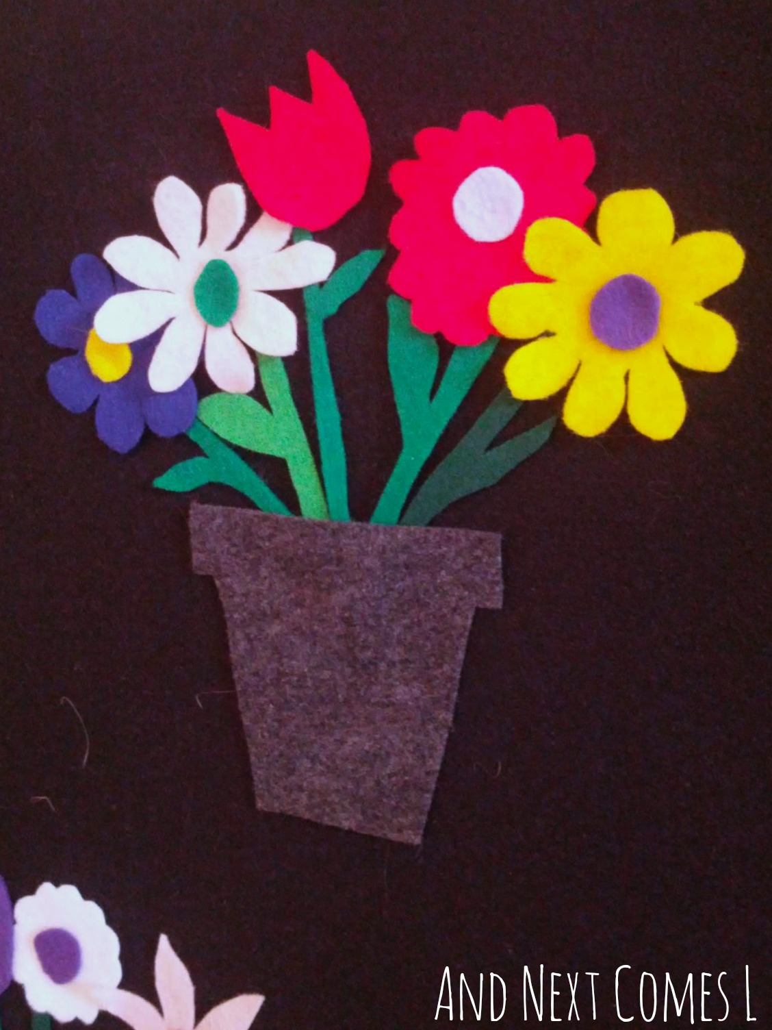Flowers on the felt board from And Next Comes L