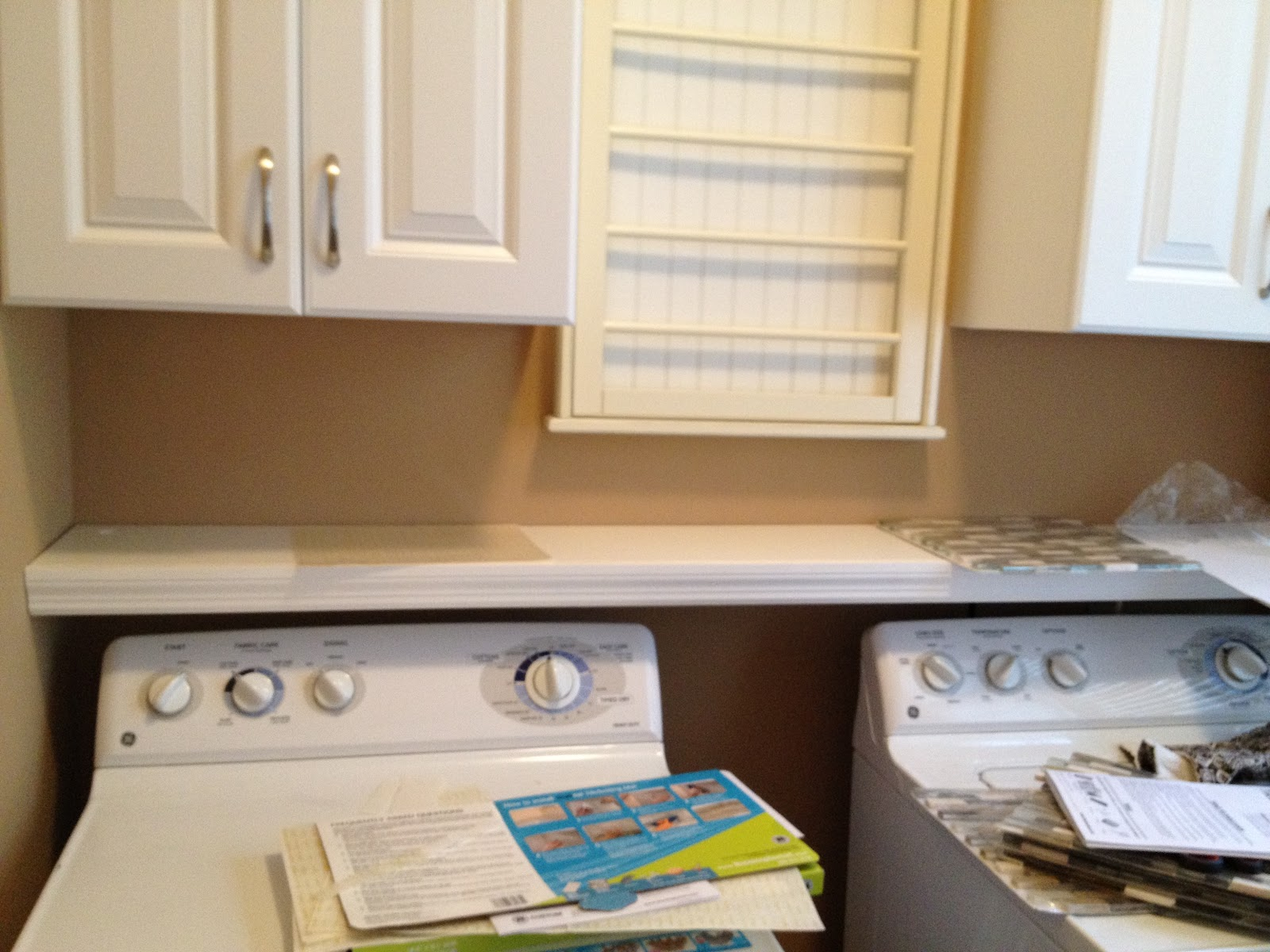 Casalupoli Laundry Room Update Over The Washer Dryer Shelf