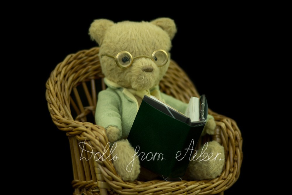 ooak artist teddy bear sitting in chair reading a book